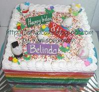 rainbow cake dengan mainan