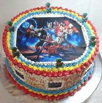 raiinbow cake dengan edible foto Ultraman buat Oziel