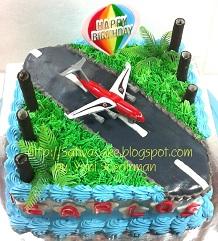 cake ultah mainan pesawat for carlos